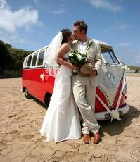 Red Volkswagen Camper on the Beach